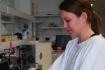 Image of a female researcher doing work in a laboratory