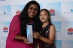 Dr Antoinette Anazodo and her daughter at the 2018 Premier's Awards, recognising excellence in public service.